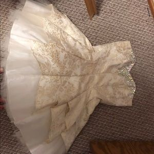 Gold and white dress with jewels on neck and chest